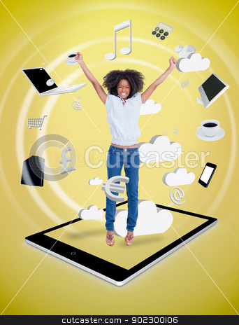 Happy woman jumping on a tablet pc stock photo, Happy woman jumping on a tablet pc against a digital yellow background by Wavebreak Media