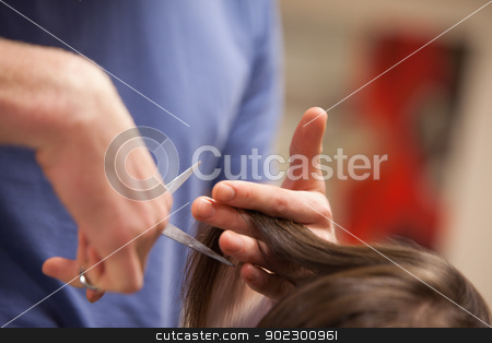 Close up of a masculine hand cutting hair stock photo, Close up of a masculine hand cutting hair with scissors by Wavebreak Media