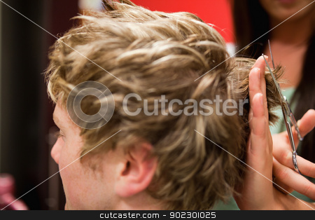 Student having a haircut stock photo, Student having a haircut with scissors by Wavebreak Media