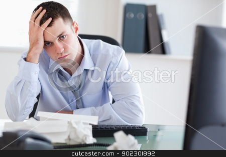 Close up of frustrated businessman doing his accounting stock photo, Close up of frustrated young businessman doing his accounting by Wavebreak Media