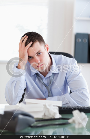 Close up of businessman being unhappy about accounting stock photo, Close up of frustrated businessman being unhappy about accounting by Wavebreak Media