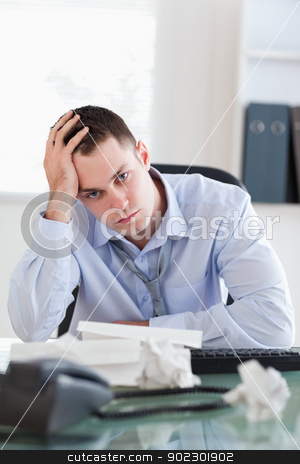 Close up of businessman being depressed by accounting stock photo, Close up of unhappy businessman being depressed by accounting by Wavebreak Media