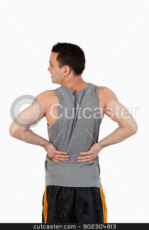 Portrait of a man having a back pain stock photo, Portrait of a man having a back pain against a white background by Wavebreak Media