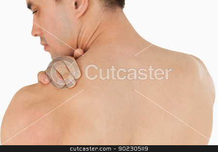 Young male with neck pain stock photo, Young male with neck pain against a white background by Wavebreak Media