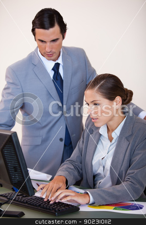 Businesswoman showing screen to her colleague