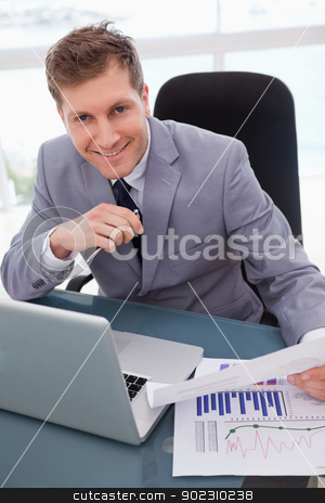 Businessman happy about market research results stock photo, Smiling businessman happy about market research results by Wavebreak Media