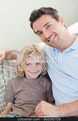 Father and son sitting on sofa stock photo, Father and son sitting on the sofa by Wavebreak Media