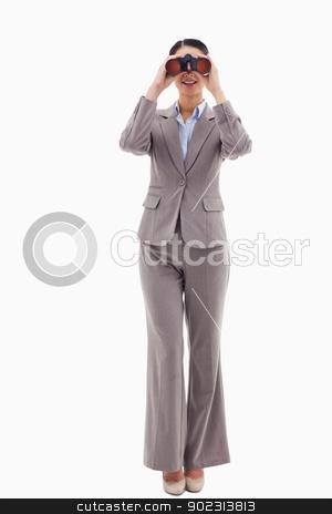 Portrait of a businesswoman looking through binoculars