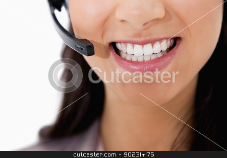 Smiling businesswoman with headset stock photo, Smiling businesswoman with headset against a white background by Wavebreak Media