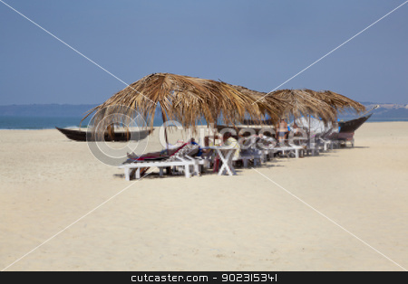 Holidaymakers basking on secluded beach