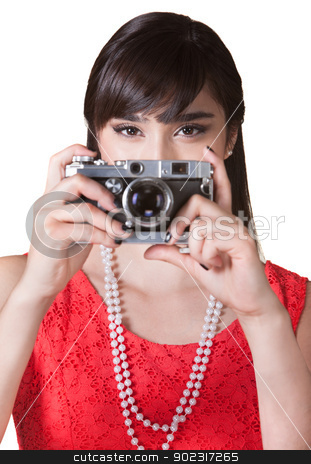 Lady Holding a Camera stock photo, Female photographer with antique point and shoot camera by Scott Griessel