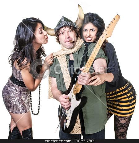 Groupies with Rock Musician stock photo, Sexy groupies around smoking heavy metal guitarist by Scott Griessel