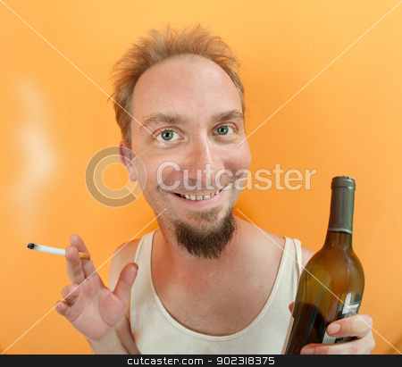 Man with alcohol and cigarette stock photo, Caucasian man holding a cigarette and a alcohol bottle with a big smile by Scott Griessel