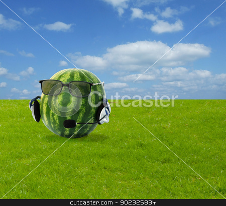 Head-like watermelon in headphone and eyeglasses stock photo, A head-like watermelon in a headphone and eyeglasses by vaeenma