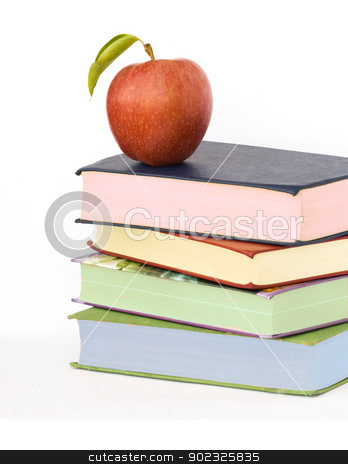 Pile of books and apple stock photo, Pile of books and apple by vaeenma