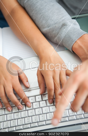 High view of students hands working with a laptop stock photo, High view of students hands working with a laptop while typing and pointing the screen by Wavebreak Media