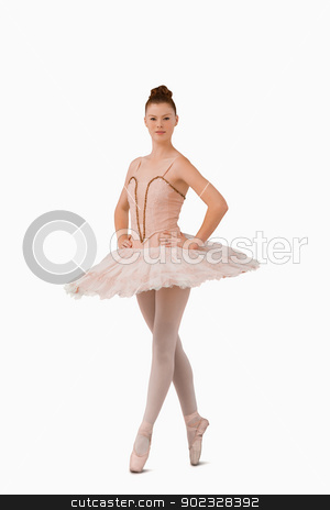 Ballerina standing on her tiptoes stock photo, Ballerina standing on her tiptoes against a white background by Wavebreak Media