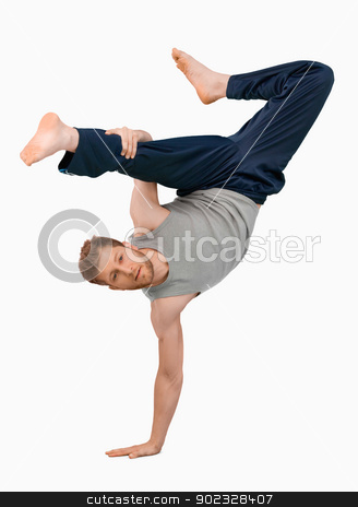 Break dancer doing an one handed handstand stock photo, Break dancer doing an one handed handstand against a white background by Wavebreak Media