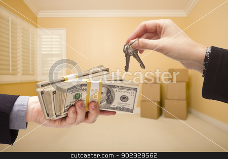 Handing Over Cash For House Keys stock photo, man and Woman Handing Over Cash For House Keys Inside Empty Room with Boxes. by Andy Dean
