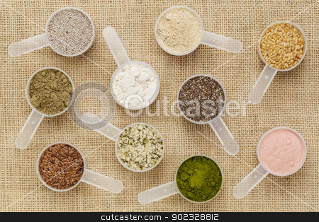scoops of superfood stock photo, scoops of superfood - healthy seeds and powders (white and black chia, flax, hemp, pomegranate fruit powder, wheatgrass, hemp and whey protein, maca root) on canvas by Marek Uliasz