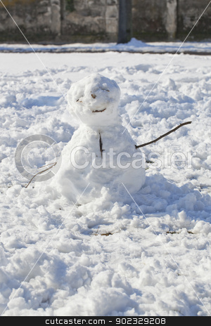Snowman stock photo, A little snowman with wooden branches for arms by Fabio Alcini
