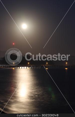 Full Moon Rise stock photo, Full moon rise over the Goleta pier. by Henrik Lehnerer