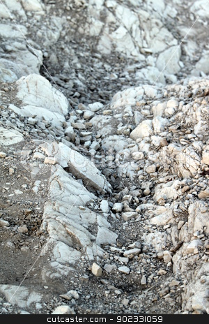 Rocks stock photo, Abstract gray rock on the ground. by Henrik Lehnerer