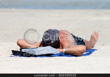 Man relaxing on beach in summer stock photo, Playa de Palma, Spain, August 23, 2012: Photograph of man relaxing on a sunny summer day on Playa de Palma beach in Mallorca,Spain.  by Martin Crowdy