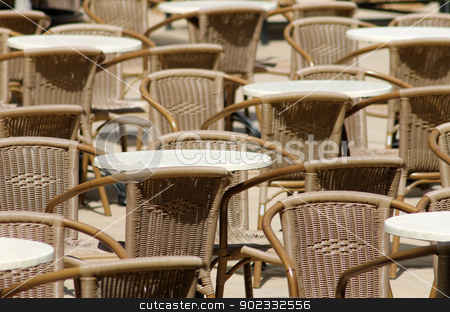 Outdoor tables and chairs stock photo, Outdoor tables and chairs in seating area. by Martin Crowdy