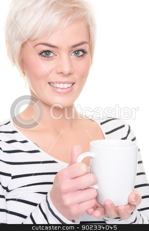 Smiling with cup stock photo, Young and smiling woman in front of white background by Picturehunter