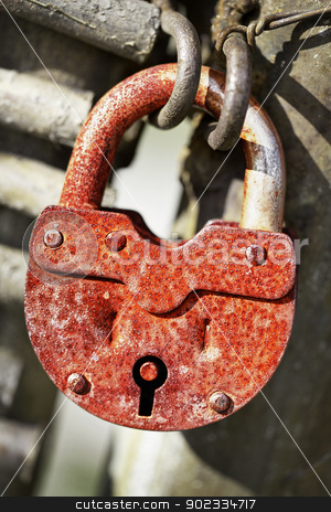 Rusty old padlock stock photo, Rusty old locked padlock on the gate by Alexey Romanov
