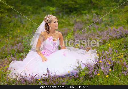Beautiful bride is sitting in the forest stock photo, A beautiful young bride is sitting alone in the woods by Alexey Romanov