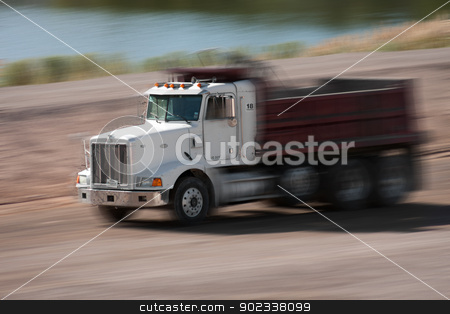 construction truck stock photo, construction truck with motion blur digitally altered by Gunter Nezhoda