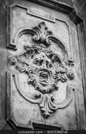 Mysterious door stock photo, Gothic mask on an old wodden door in Milan - Italy by Perseomedusa