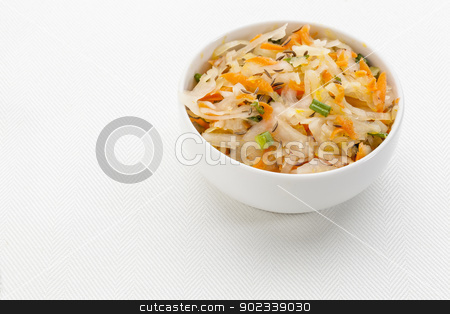 sauerkraut salad stock photo, sauerkraut salad with carrot, green onion, caraway and olive oil - a small bowl against white canvas by Marek Uliasz
