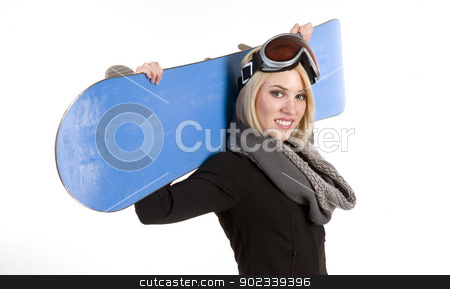Her Board Held over Shoulders stock photo, A Beautiful Blonde Woman poses with her Snowboard by Christopher Boswell