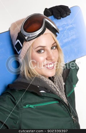 Active Woman Smiles and Looks at the Camera stock photo, A Beautiful Blonde Woman caries her Snowboard by Christopher Boswell