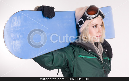 Snow Boarder Blod Woman Ready for Slopes stock photo, A Beautiful Blonde Woman looks up at the slopes by Christopher Boswell