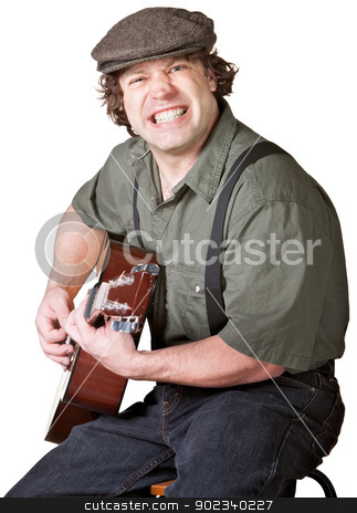 Guitarist with Clenched Teeth stock photo, Handsome Caucasian male with guitar clenched teeth by Scott Griessel
