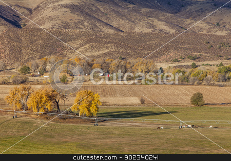 farmland at Colorado foothills stock photo, farmland at foothills of Rocky Mountains at Belvue near Fort Collins, Colorado; fall scenery at sunrise by Marek Uliasz