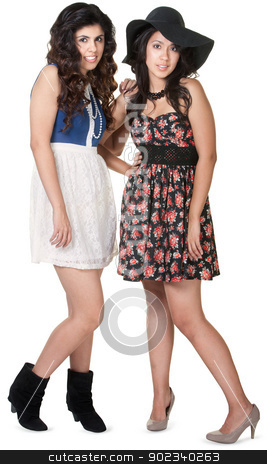 Two Hipster Sisters stock photo, Mexican sisters together over isolated white background by Scott Griessel