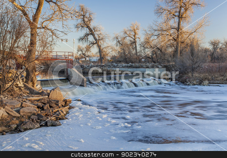 river dam stock photo, small river dam diverting water to farmland irrigation - South Platte River near Fort Lupton, Colorado, winter scenery at sunset by Marek Uliasz
