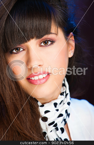 Pretty woman with white scarf stock photo, Pretty woman with white scarf with black dots on it by iMarin