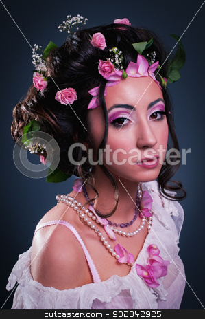 Young girl with creative hairstyle stock photo, Young girl with creative hairstyle with flowers by nvelichko