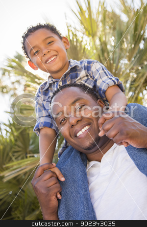 Mixed Race Father and Son Playing Piggyback stock photo, Happy Mixed Race Father and Son Playing Piggyback in the Park. by Andy Dean
