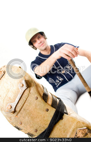 Young baseball player stock photo, Young baseball player sitting against white background by Mirko Pernjakovic