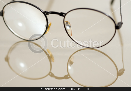 Glasses stock photo, Glasses on mirrored surface by Mirko Pernjakovic