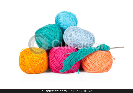 Multicolored set of yarn for knitting on white stock photo, Multicolored set of yarn for knitting isolated on white background by Alexander Tarasov