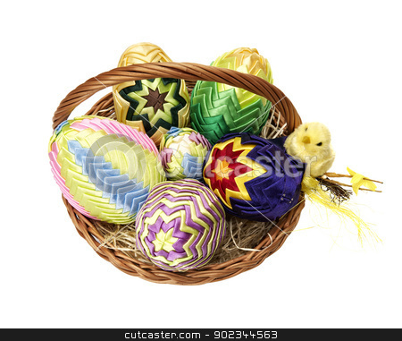 Easter eggs in wicker basket  stock photo, Easter eggs in wicker basket  on white background. by Filip Warulik