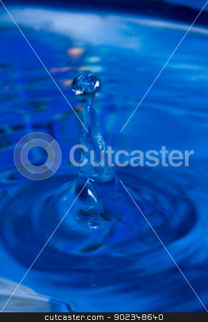 Water dripping stock photo, Water dripping on a blue background by Jennifer Solpietro